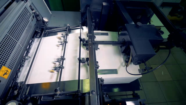 paper production machine. processing of secondary resources. special equipment works at a print office. - мембрана клетки стоковые видео и кадры b-roll