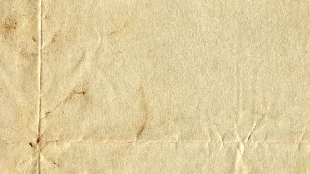 vidéos et rushes de texture de papier feuille de papier brun - texture papier