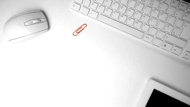 Paperclip falling in the middle of an office desk video
