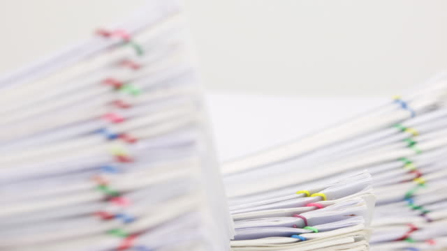 Paperwork have blur document as foreground and background time lapse video