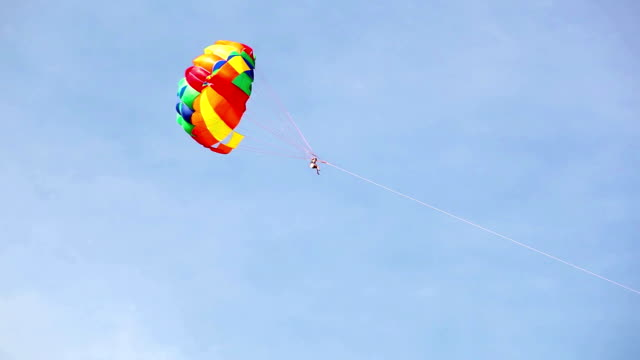 Parachute hauled by the motorboat flying in the sky video