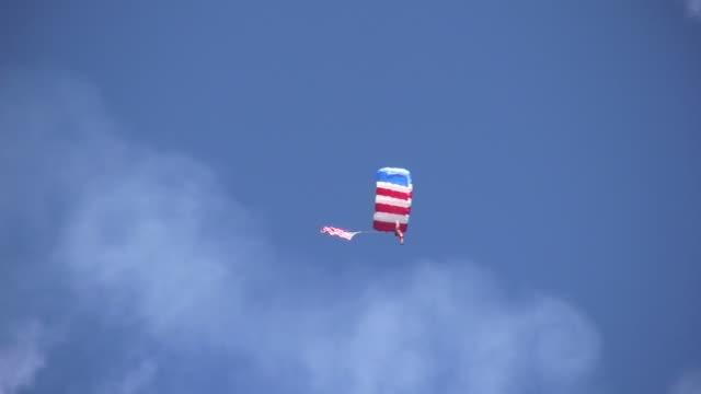 Parachutist carrying American Flag video