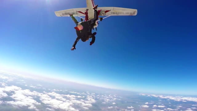 Parachutist Tandem Jumping Parachutist jumping in tandem out of an sport airplane hobbies stock videos & royalty-free footage