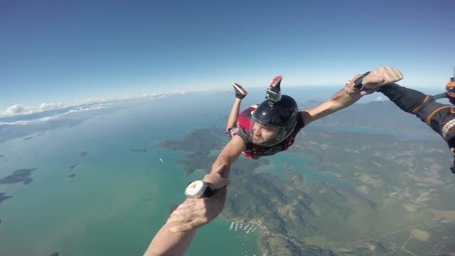 Parachutists on vacation have fun over the Atlantic sea.