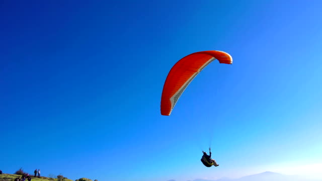 paraglider activity fly with beautiful background - парапланеризм стоковые видео и кадры b-roll
