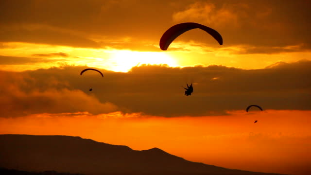 Paraglider silhouette at sunset video