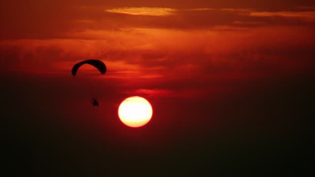 Paraglider, sunset. video