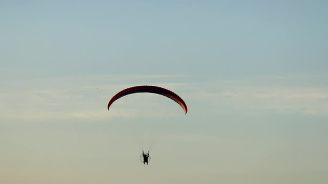 Paraglider with blue sky background. video
