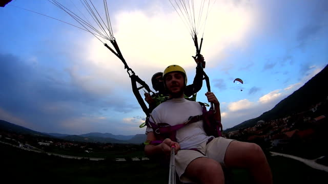 Paragliders enjoying sunset