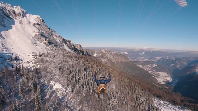 Paragliding flying in winter alpine mountains, Beauty freedom of free flight adrenaline adventure in snowy nature landscape