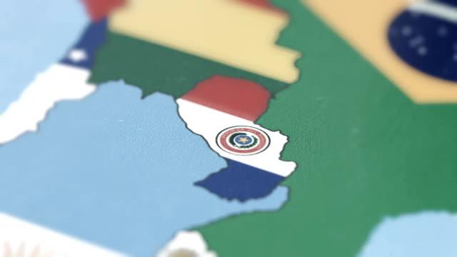 paraguay borders wiht national flag on world map - парагвай стоковые видео и кадры b-roll