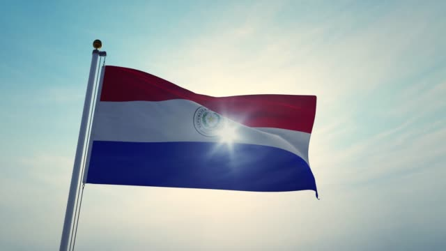 paraguay flag flying backlit in the sky - video 3d animation - парагвай стоковые видео и кадры b-roll
