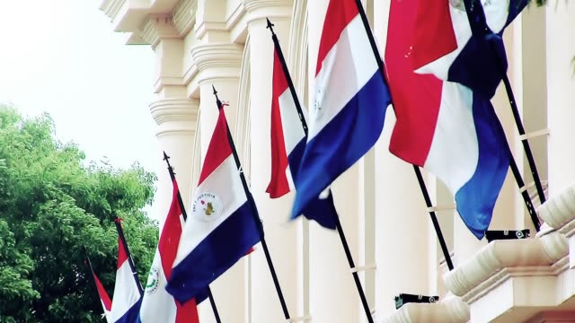 paraguay flags in a building of asuncion (paraguay). - парагвай стоковые видео и кадры b-roll
