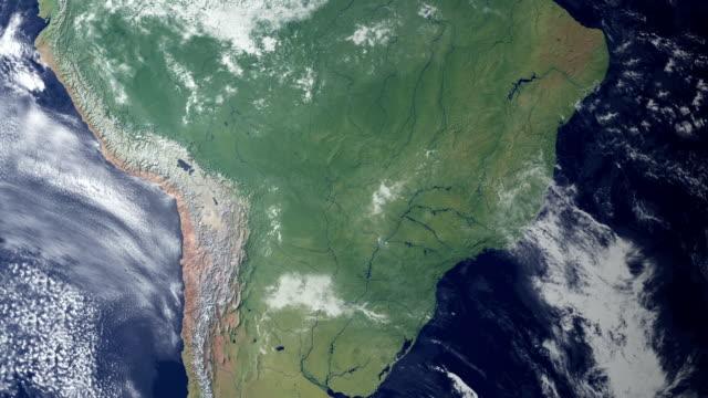 vídeos de stock e filmes b-roll de paraguai aparece depois de terra zoom (com alpha matte) - américa do sul