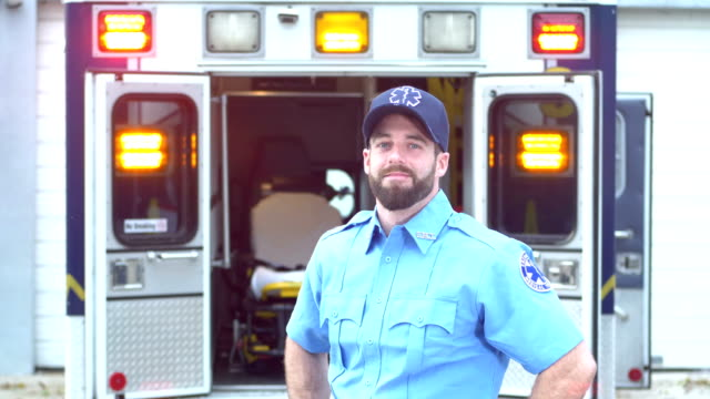 paramedic standing in front of ambulance - paramedic stock videos & royalty-free footage