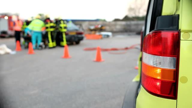 Paramedic with ambulance on a car crash. Paramedic with ambulance on a car crash. rescue worker stock videos & royalty-free footage