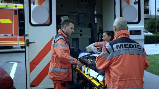 Paramedics loading the injured person into the ambulance video