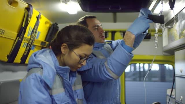 paramedics posing inside ambulance - first responders filmów i materiałów b-roll