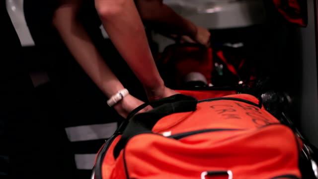 Paramedics preparing equipment in ambulance