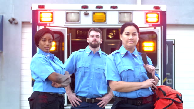 paramedics standing in front of ambulance - paramedic stock videos & royalty-free footage
