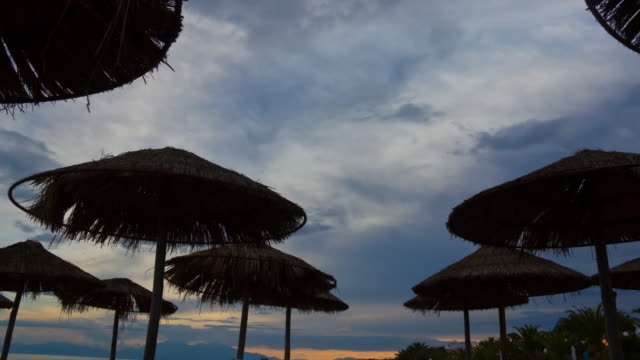 Parasols  sunset to night time lapse stock videos & royalty-free footage