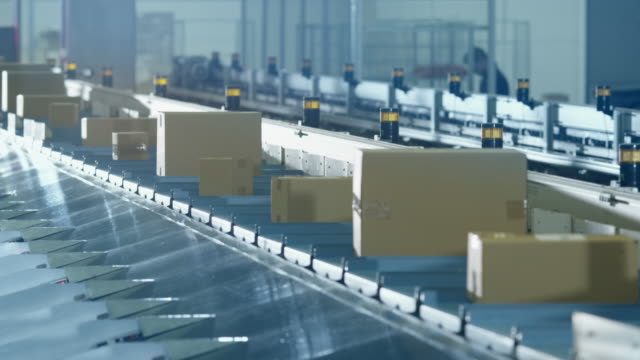 Parcels are Moving on Belt Conveyor at Post Sorting Office. video