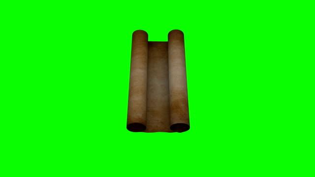 pergament scroll rolling out green screen - tora stock-videos und b-roll-filmmaterial