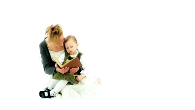 Parent read a book. Child listen of the mother reading. video