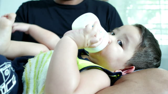 parent take care little boys , drinking milk video