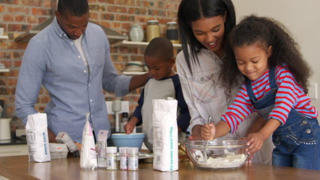 Parents And Children Baking Cakes In Kitchen Together video