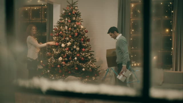 Parents decorating christmas tree video