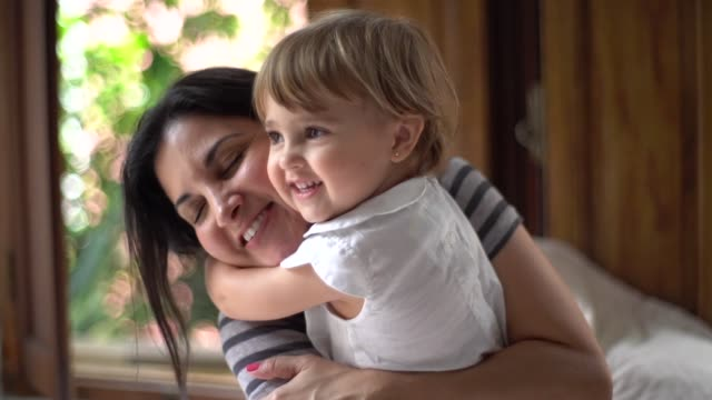 Parents Having Fun with a Cute Daughter Domestic Life hug stock videos & royalty-free footage