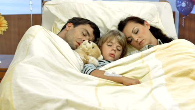 HD DOLLY: Parents Sleeping Next To A Sick Child video