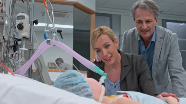 DS Parents talking to their daughter in the intensive care unit video