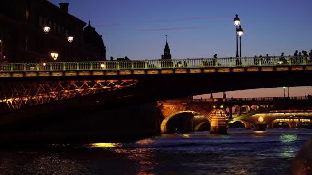 Paris at night. Banks of Seine river, illuminated bridges.