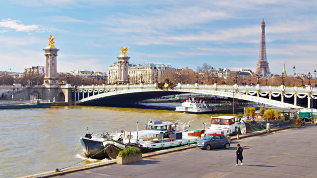 Paris Background. Eiffel Tower. Famous Bridge and Riverbank. Boats.