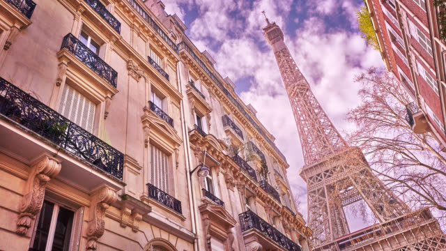 Paris City. Eiffel Tower. Magnificent Architecture. Residential Building. Clouds.
