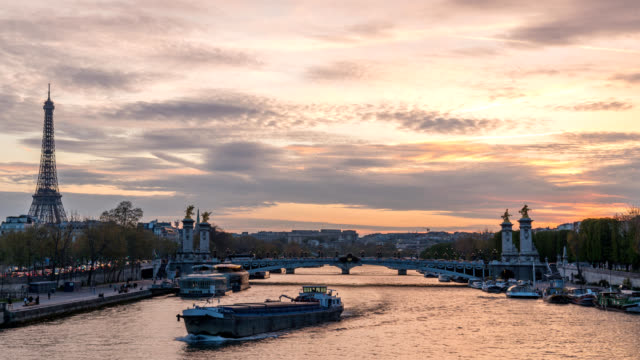 paris france time lapse 4k, city skyline day to night sunset timelapse at seine river with pont alexandre iii bridge - french architecture stock videos & royalty-free footage