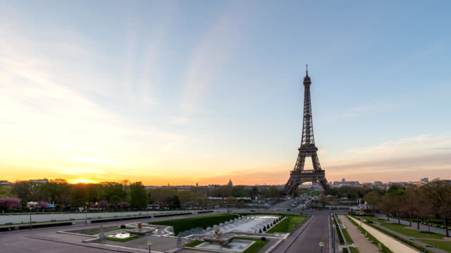 Paris France time lapse 4K, city skyline sunrise timelapse at Eiffel Tower and Trocadero Gardens