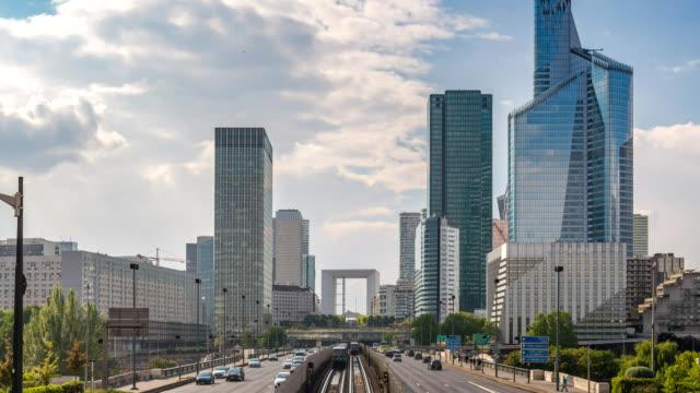 Paris France time lapse 4K, city skyline timelapse at La Defrense business district