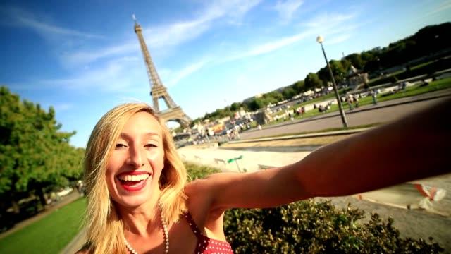 Parisian girl takes selfie portrait at the Eiffel tower video