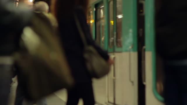 Parisian metro, winter Medium shot of Parisians waiting for the subway train to arrive, Paris, France. subway platform stock videos & royalty-free footage