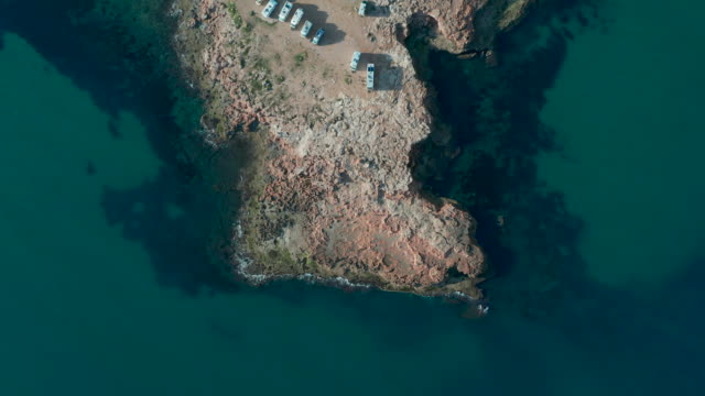 RV park campground on a rock near the sea. Aerial view of parking, from above