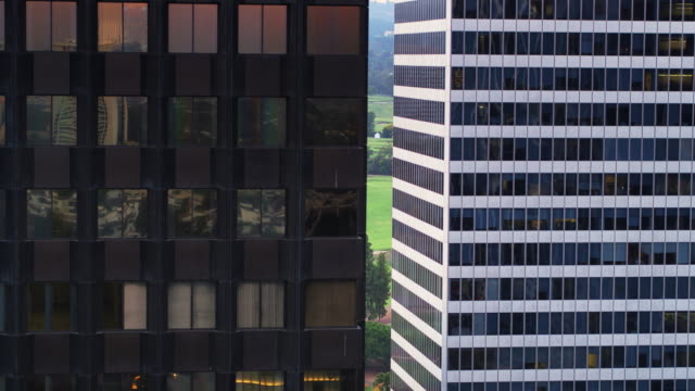 Park Visible Between Office Towers - Drone Shot video