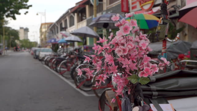 Parked red trishaws in Penang , Malaysia