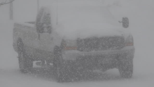 Parked Truck Snowing Hard video
