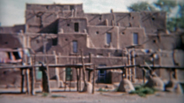 TAOS, NEW MEXICO 1955: Parking by the church at the Taos Native American Pueblo.