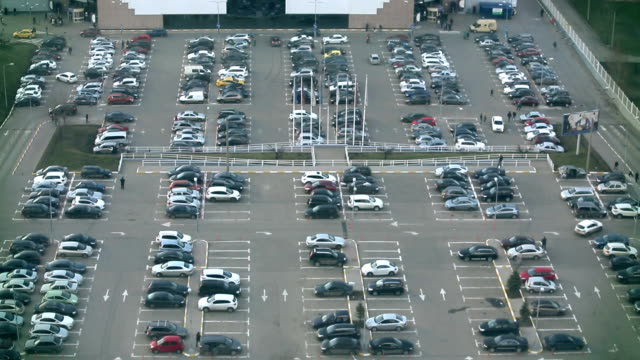 Parking lot full of cars and peoples video