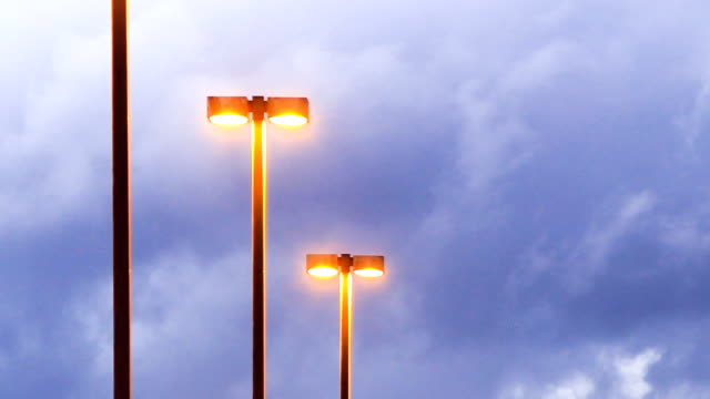 Parking lot lights and dark clouds - time lapse video
