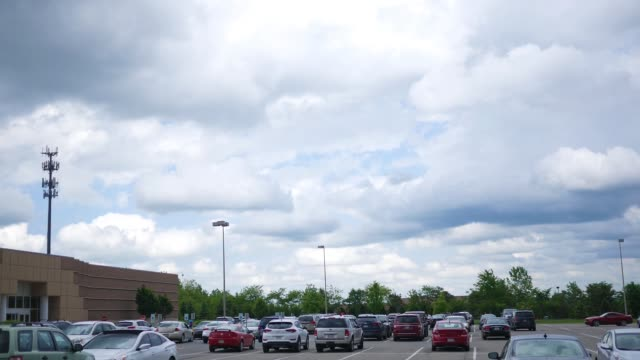 a parking lot near a shopping mall with cars parked - joseph kelly stock videos and b-roll footage